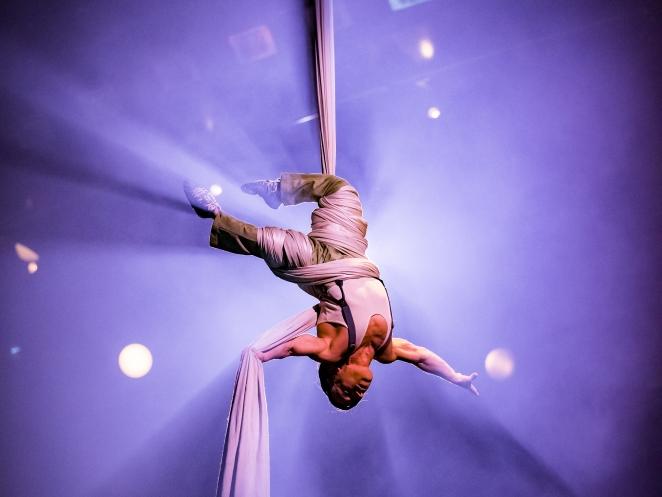 Performer Alan Silva performs astounding aerial tissu act