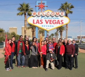 "AFAN Executives and community members turn ""Welcome to Fabulous Las Vegas Sign Red"